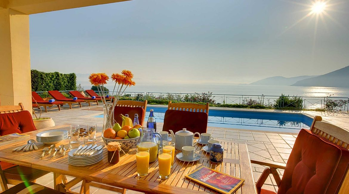 Fiskardo House outside dining with pool and sea views