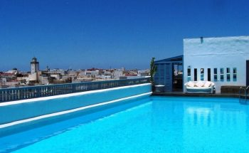 The rooftop pool and terrace at L'Heure Bleue